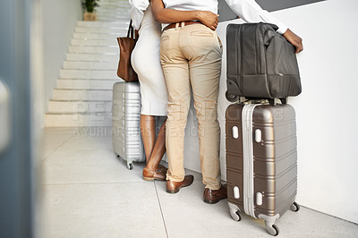 Buy stock photo Rearview shot of an unrecognizable affectionate couple standing with their luggage at the reception of a hotel