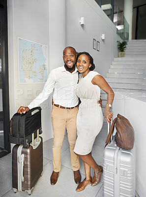 Buy stock photo Full length shot of a happy young couple standing with luggage and checking in at a hotel