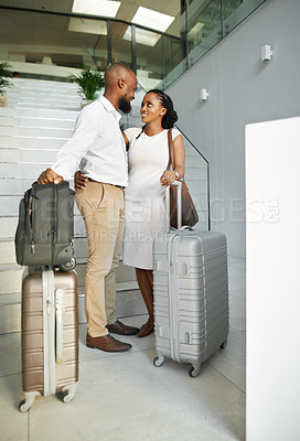 Buy stock photo Full length shot of a happy young couple standing with their luggage and checking in at a hotel