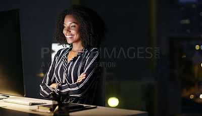 Buy stock photo Cropped shot of an attractive young businesswoman sitting at her desk in the office late at night