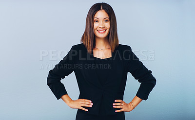 Buy stock photo Studio shot of a confident young businesswoman posing against a grey background