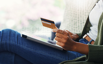 Buy stock photo Cropped shot of an unrecognizable woman using a tablet for online shopping while sitting on the sofa