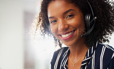 Buy stock photo Cropped portrait of an attractive young businesswoman wearing a headset while in the office during the day