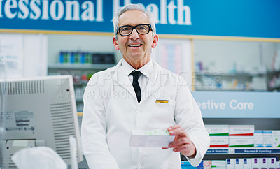 Buy stock photo Cropped shot of a male pharmacist working in a chemist
