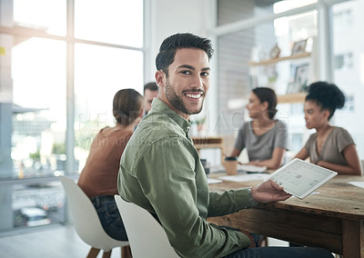 Buy stock photo Portrait of a confident young man having a team meeting in a modern office