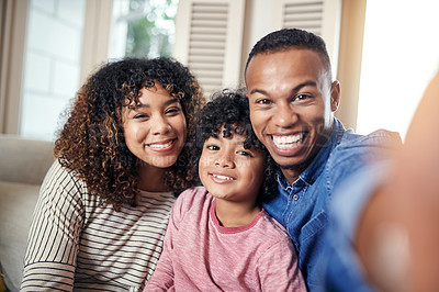 Buy stock photo Cropped shot of a family of three taking a selfie together