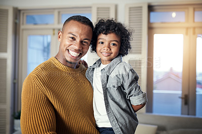 Buy stock photo Cropped shot of a young man spending time with his son at home
