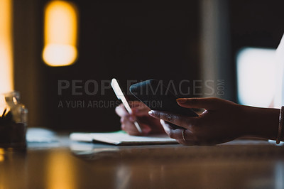 Buy stock photo Closeup shot of an unrecognisable businesswoman using a cellphone in an office at night