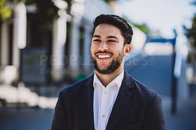 Buy stock photo Shot of a happy young businessman in the city