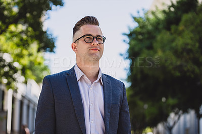 Buy stock photo Shot of a confident young businessman in the city