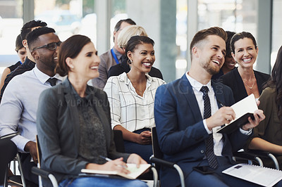 Buy stock photo Shot of a group of businesspeople attending a conference