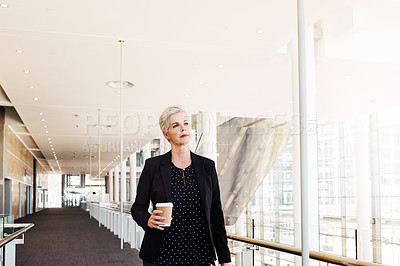 Buy stock photo Shot of a mature businesswoman walking through an airport