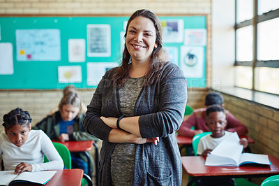 Buy stock photo Shot of a confident young woman teaching a class of young children at school