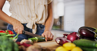 Buy stock photo Cropped shot of an unrecognizable woman cutting vegetables