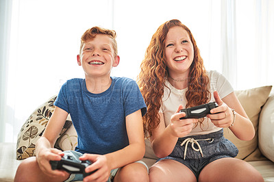 Buy stock photo Shot of a cheerful brother and sister playing video games together at home