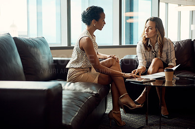 Buy stock photo Full length shot of two young businesswomen shaking hands after having a meeting in a modern office