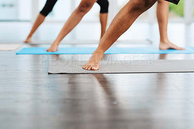 Buy stock photo Shot of an unrecognizable group of people practicing yoga inside a studio