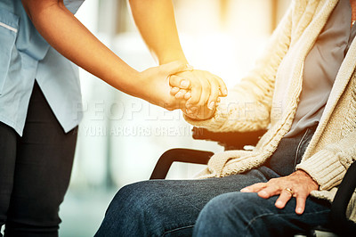 Buy stock photo Cropped shot of a nurse caring for a senior woman with a wheelchair