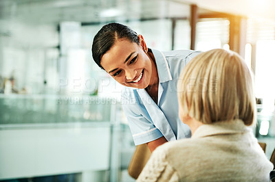 Buy stock photo Shot of a young nurse caring for a senior woman