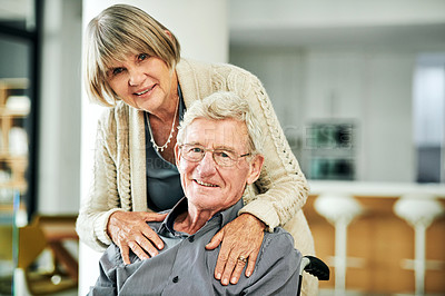 Buy stock photo Shot of a senior woman caring for her husband in a wheelchair