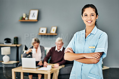Buy stock photo Portrait of a female nurse standing with her arms crossed