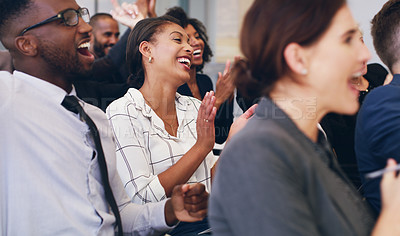 Buy stock photo Cropped shot of a diverse group of businesspeople sitting and clapping while in the office during the day