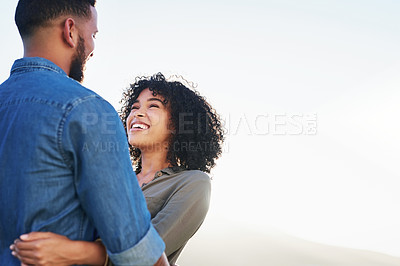 Buy stock photo Cropped shot of a happy young couple looking affectionately at each other while on a date during the day