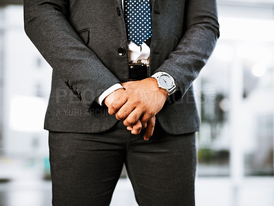 Buy stock photo Closeup shot of a businessman standing in an office