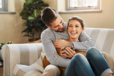 Buy stock photo Cropped shot of a young couple relaxing on the sofa at home