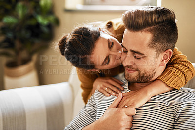 Buy stock photo Shot of an affectionate couple spending quality time together at home