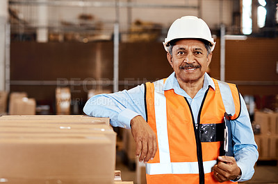 Buy stock photo Shot of a confident mature man working in a warehouse