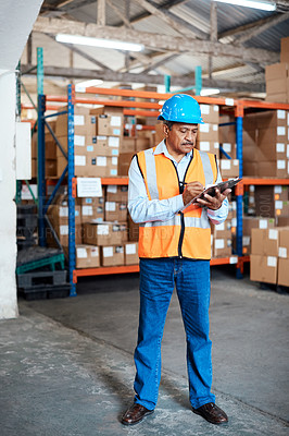 Buy stock photo Shot of a mature man doing inventory in a warehouse