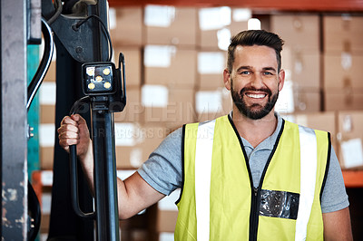 Buy stock photo Cropped portrait of a handsome young male warehouse worker standing beside a forklift