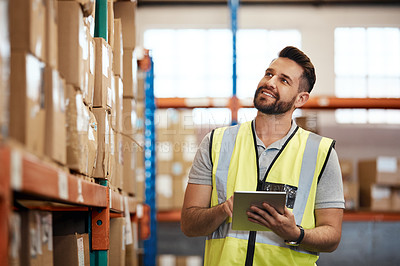 Buy stock photo Cropped shot of a handsome young male warehouse worker checking stock