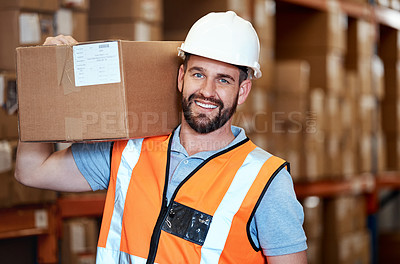 Buy stock photo Portrait of a young man holding a box while working in a warehouse