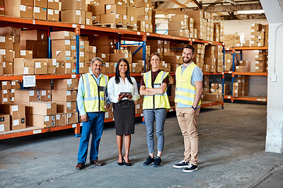 Buy stock photo Portrait of a group of factory workers standing together in a warehouse