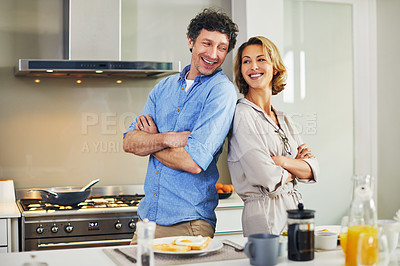 Buy stock photo Portrait of a confident mature couple preparing breakfast together at home