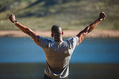 Buy stock photo Shot of a sporty young man cheering after finishing his workout