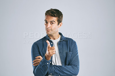 Buy stock photo Cropped shot of a handsome man pointing at the camera