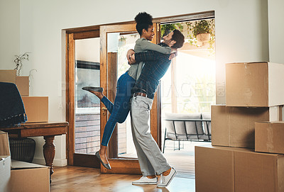 Buy stock photo Full length shot of an affectionate middle aged man lifting his wife in celebration while moving into a new home
