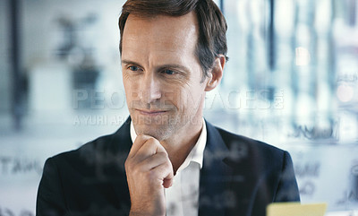 Buy stock photo Shot of a mature businessman looking thoughtful while brainstorming with notes on a glass wall in an office