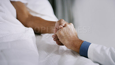 Buy stock photo Closeup shot of a doctor holding a patient's hand in comfort in a hospital ward