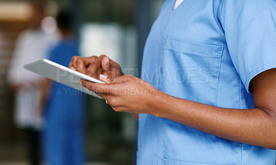 Buy stock photo Closeup shot of an unrecognisable nurse using a digital tablet in a hospital