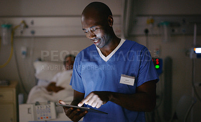 Buy stock photo Shot of a medical practitioner using a digital tablet in a hospital ward