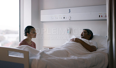 Buy stock photo Shot of a woman visiting an elderly patient in a hospital