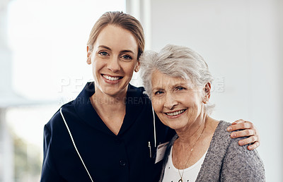 Buy stock photo Cropped shot of a young female caregiver working in a retirement home