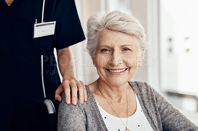 Buy stock photo Shot of a senior woman in a wheelchair being pushed by a female nurse