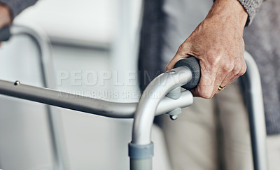Buy stock photo Shot of an unrecognizable senior woman walking with the assistance of a walker