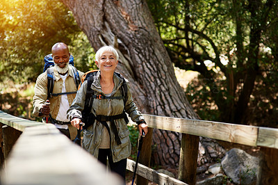 Buy stock photo Shot of a senior couple enjoying themselves while out for a hike