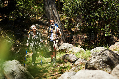 Buy stock photo Shot of a senior couple out for a hike on a sunny day
